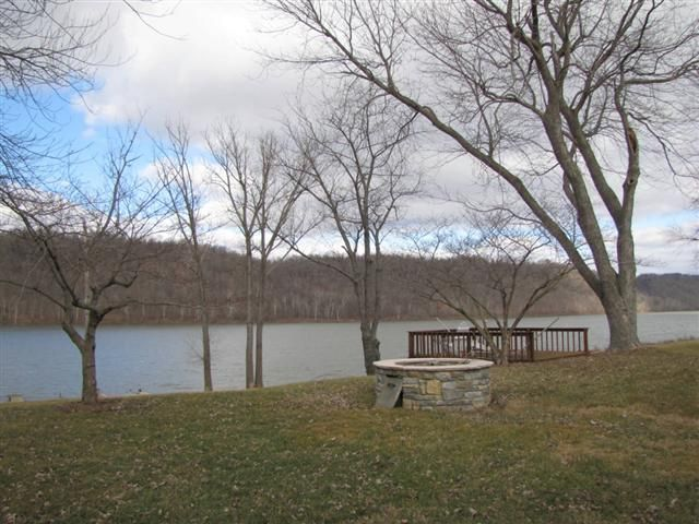 BEAUTIFUL WATERFRONT PROPERTY upstream with calm waters and less traffic Make this weekend retreat yours located on the bank of the Ohio in Westport KYThis home offers over 1300 square feet a large covered deck overlooking the serene water view a large 2 car garage with ample depth for boat storage a recently installed concrete drive thats spacious for maneuvering your boat trailer a beautiful stone fire pit a second deck and best of all....your own private dock Purchase just in time for a…