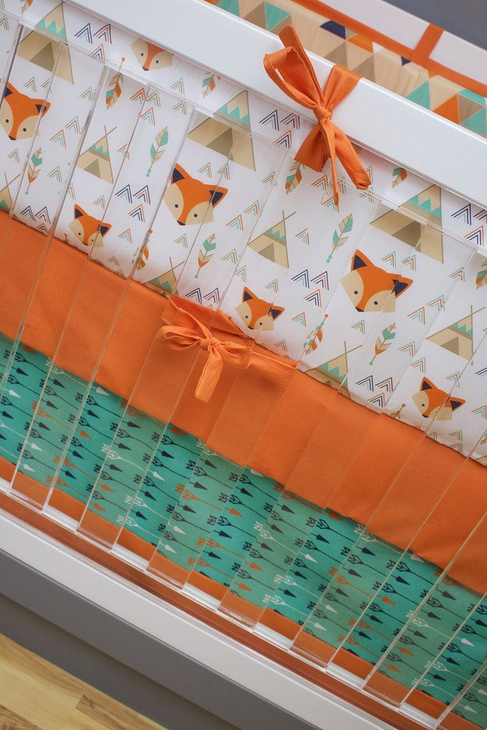 I am loving this fox crib bedding for your fox themed nursery! Perfect colors palette of orange, teal and navy. Bonus, teepees!