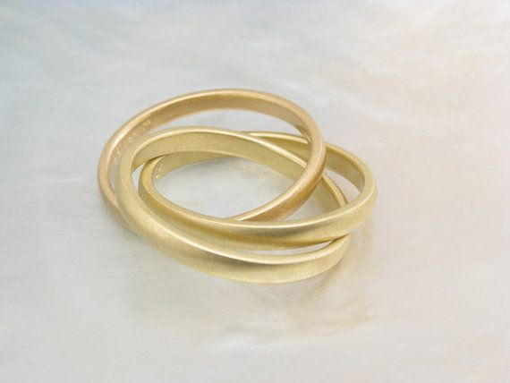 Russian wedding ring...a cord (ring) of three strands is not quickly broken...God, him, me.
