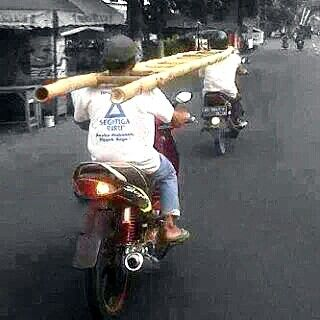 Indonesia -transporting a ladder