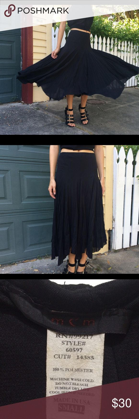 Fun flare midi skirt in black I just want to twirl all day in this skirt! Size small but very stretchy. In the photo I'm wearing it high-waisted but can be worn on hips. (My stats are 5'6'' and 110 lbs). Label looks like MCM brand but not positive. MCM Skirts Midi