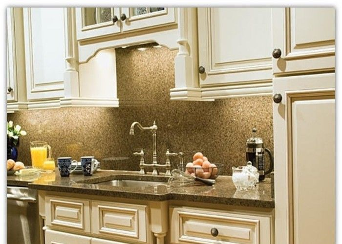 Kitchens with white glazed cabinets and chandeliers for Antique glazed kitchen cabinets