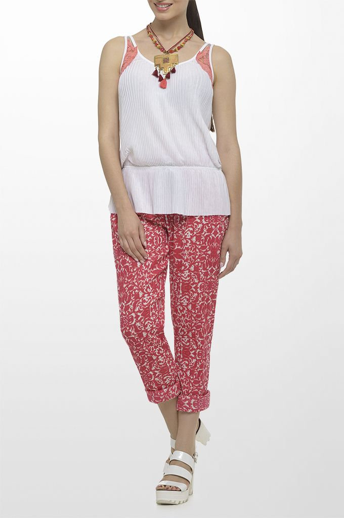 Sarah Lawrence - sleeveless top with lace details, draw string loose printed trouser, necklace with beads & tassels.