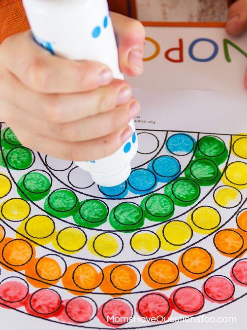 dot markers (bingo pens) make a dot rainbows- fine motor skills