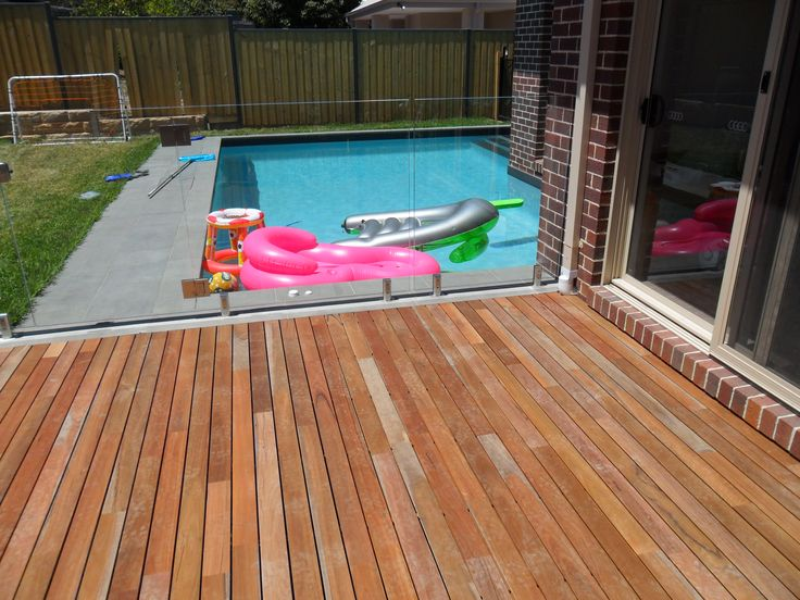 Glen Iris - decking around the pool. House cantilevers to sit on top of pool edge.