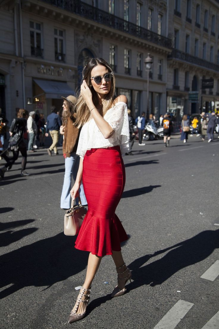 Bold street-style inspired work-wear, featuring a deep red midi skirt, off the shoulder white lace top, and transparent sunnies.