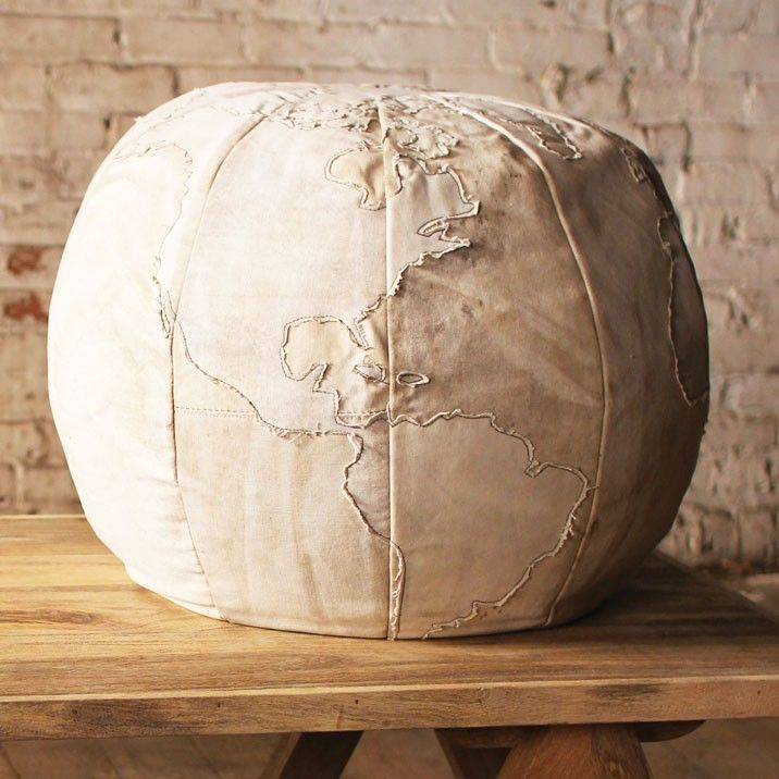 Sit on top of the world with the Canvas Globe Pouf. Featuring recycled canvas, this is sure to appeal to the curious and the bold in your home. When you're tired from your adventures, this pouf will provide the perfect place to relax and rejuvenate.