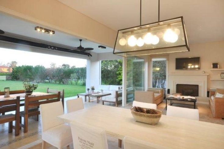 espacio integrado: Comedores de estilo Clásico por Parrado Arquitectura