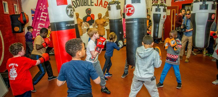 A group of volunteers teach boxers young and old at Double Jab Boxing Club.