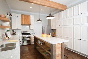 Transitional Kitchen with Crown molding, Built-in bookshelf, Kitchen island, Pendant Light, Hardwood floors, Wall sconce