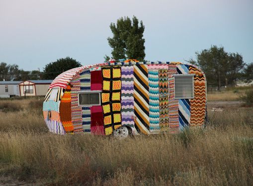A neon textile-covered trailer sits in Marfa, Texas' El Cosmico