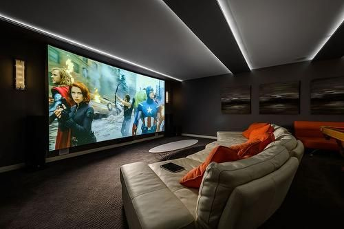 Giant screen with real colour, big cushy couch that's not too far and not too close and not decorated insane like many home theatres. ce