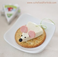 Here is a cute appetizer idea for kids! This cheese mouse was made from Happy Cow Cheese Wedge, olive, black sesame seeds, hot dog and green onion. Its pretty easy, isnt it?    Tips:   - Use straw to cut the olive nose.   - The tail can be replace with carrot, cucumber skin, etc.  - Ears can be replaced with ham, peperoni, carrot or sliced almonds!