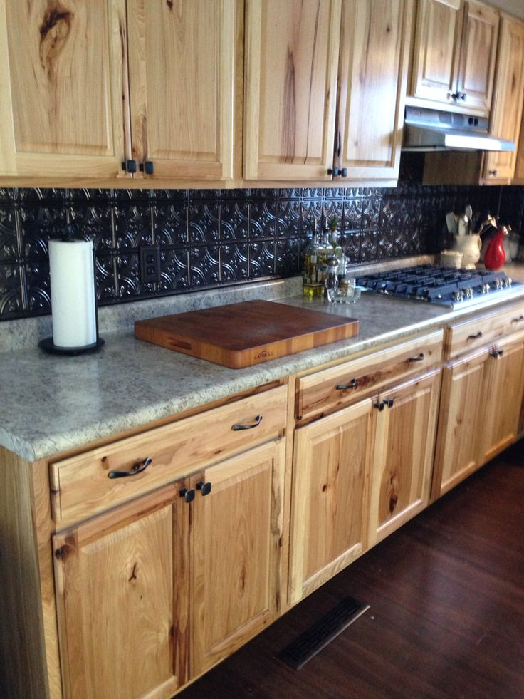 Hickory cabinets with Fasade backsplash.