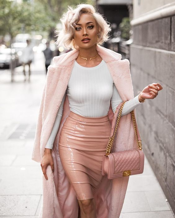 Pair a rose pink fur coat with a dusty pink leather pencil skirt to steal the show.   Shop this look on Lookastic: https://lookastic.com/women/looks/fur-coat-long-sleeve-t-shirt-pencil-skirt/23384   — Gold Earrings  — Gold Necklace  — White Long Sleeve T-shirt  — Gold Bracelet  — Pink Fur Coat  — Pink Leather Pencil Skirt  — Pink Quilted Leather Crossbody Bag