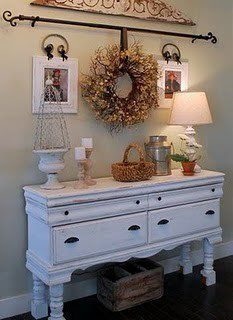 Love this use of a curtain rod to hang the wreath, and the shabby chic frames!  I SO want to duplicate this!