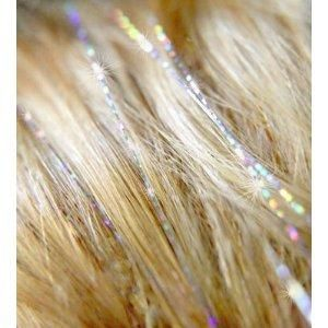Hair Tinsel? HAH! Save money by simply working at any Hallmark store at Christmastime. The stuff breeds like rabbits there...   @Michelle Flynn Flage @Kirsten Wehrenberg-Klee McClendon