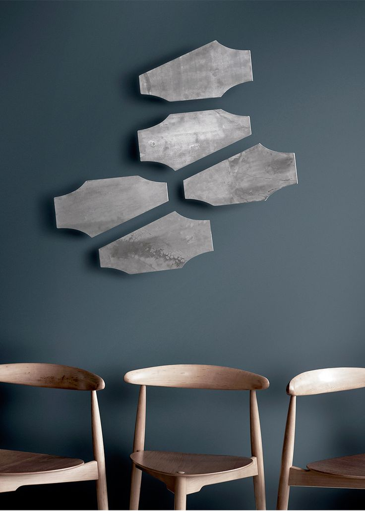 Zeppelin wall sculptures. Patinated zinc. Masculine look and inspiration.