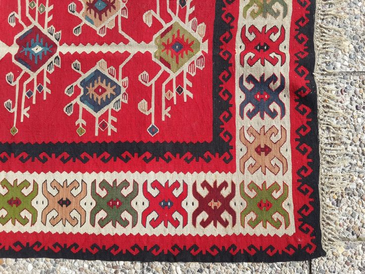 Ђулови на диреци, ченђели обични на плочи. Pirot kilim is a unique, authentic and highly regarded brand of flat tapestry-woven carpets or rugs, made of pure sheep's wool from Stara Planina, southeastern Serbia, dyed with natural colours and long enduring. It is made as a single piece, has 28 weave lines in 1cm and both sides of the rug can be used. Its colors, patterns and ornaments are unique: 96 of them are geographically protected. Pirot kilim is made exclusively in Pirot, Serbia.