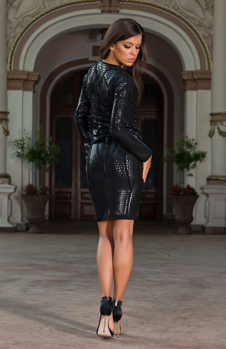 The Alvada black bodycon skirt suit incorporates sharp tailoring to add a modern sensual touch to the gothic romanticism style.