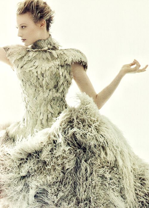 this will blur if you breathe. McQueen covers her in feathers!