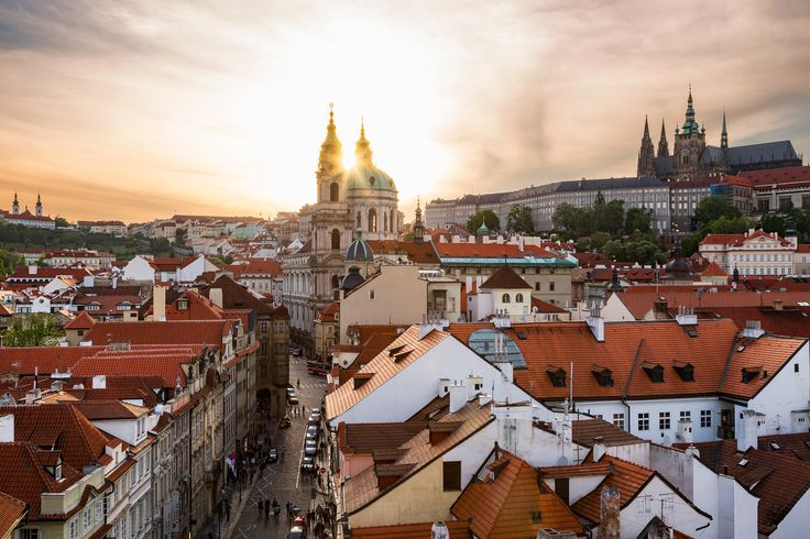 Old Town Glory - The Czech Republic, Prague. The sun setting through the spires of a Baroque church in Prague. Credits: Jonathan Reid