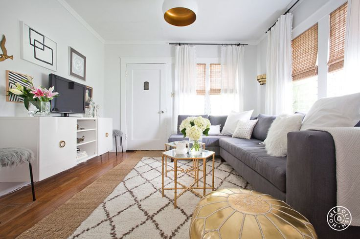 Bring the Beach Home - This apartment  is very SoCal surf meets Hollywood glam. Gold accents on a fuzzy rug are the glam part and gray mainstay furniture keeps the space grounded. Rattan blinds give the light a nice hue and kind of make you feel like you're in a tiki hut. by Homepolish Los Angeles https://www.homepolish.com/mag/homepolish-handbook-bring-the-beach-home