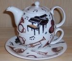 """Capture the essence of music with this unique teapot with a musical theme. Music lovers will appreciate this """"musical theme tea for one. This tea for one stackable teapot, cup and saucer are fine bone china, made in England by Roy Kirkham. Microwave and dishwasher safe."""
