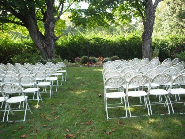 Brown Chairs Outdoor Ceremony Decorations: White Fan Back Chairs Setup For A Wedding Ceremony