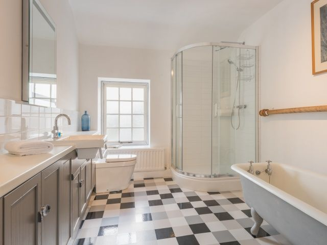 Large Bathroom With Shower Enclosure And Freestanding Bath