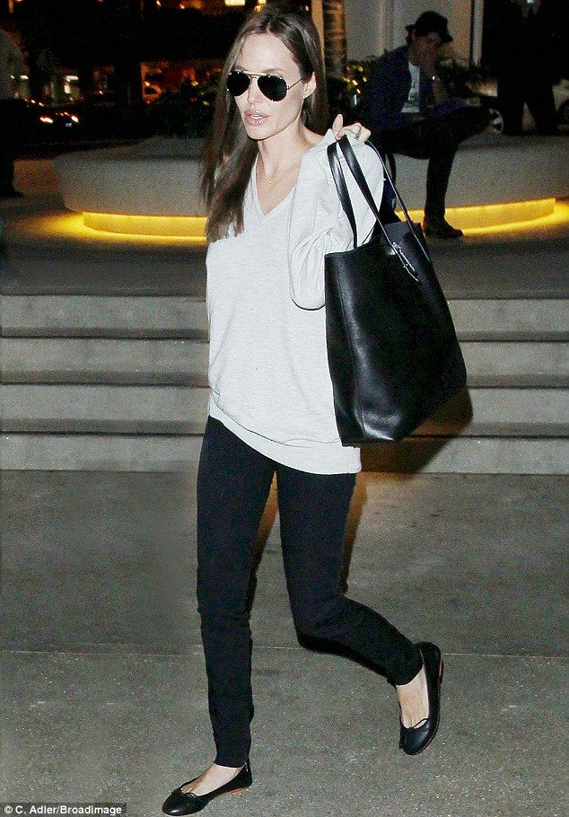 Arriving at London's Heathrow airport on Saturday, Angelina Jolie was spotted holding Everlane's Petra bag; a low-profile and classic carry-...