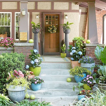 Add color to your entrance with containers packed with flowers. Get more ideas for a welcoming entrance: http://www.bhg.com/gardening/plans/special-spots/planning-a-welcoming-entry-garden/?socsrc=bhgpin062912