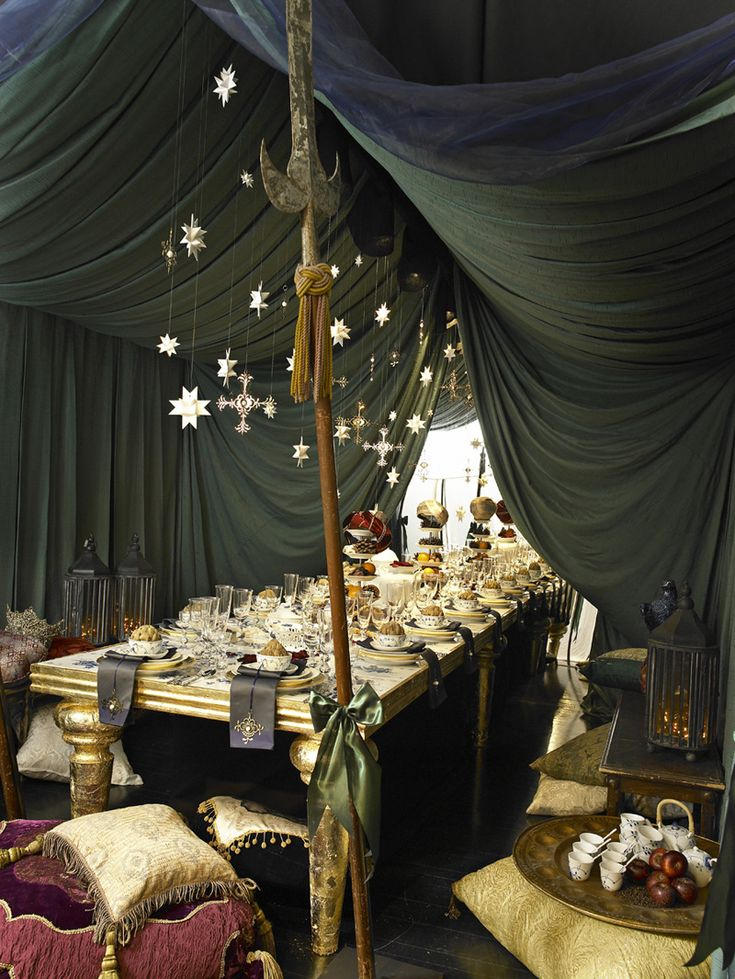 Medieval Christmas... the fabric draped above the table adds such an elegant touch to an otherwise rustic table.  I love it!