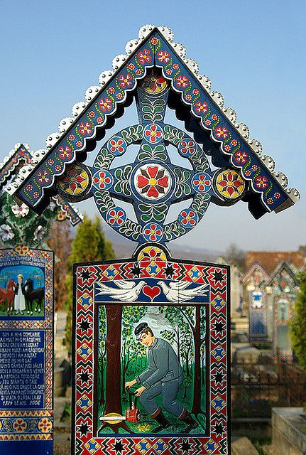 Headstone from the Marry Cemetery - Sapinta, Maramures, Romania. The unique cemetery is famous for its colorful tombstones decorated with naïve paintings and short original folk rhyming descriptions of the people buried there and of scenes from their lives. www.romaniasfriends.com