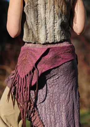 This is an AMAZING piece of artwear !!! One of a kind ! Feminine and Earthy at the same time. Fits nice as a layer over a dress , skirt or pants . I made this belt/pocket in soft merino wool in magenta color and Ive added some textures into it with Alpaca Silk fibers in dark brown . There is so many details into this unique creation. A beautiful spiral symbol is adorning the back pocket ( not shown on the pictures ) . A symbol that activate movement ! It is felted thin and lightweight ...