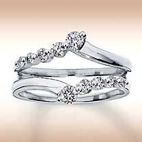 What do yo think of using a diamond enhancer as my wedding band? Is this common? I have a marquis cut diamond engagement ring which I would like to continue to wear after the wedding- but I'm worried most bands won't match up to the setting...