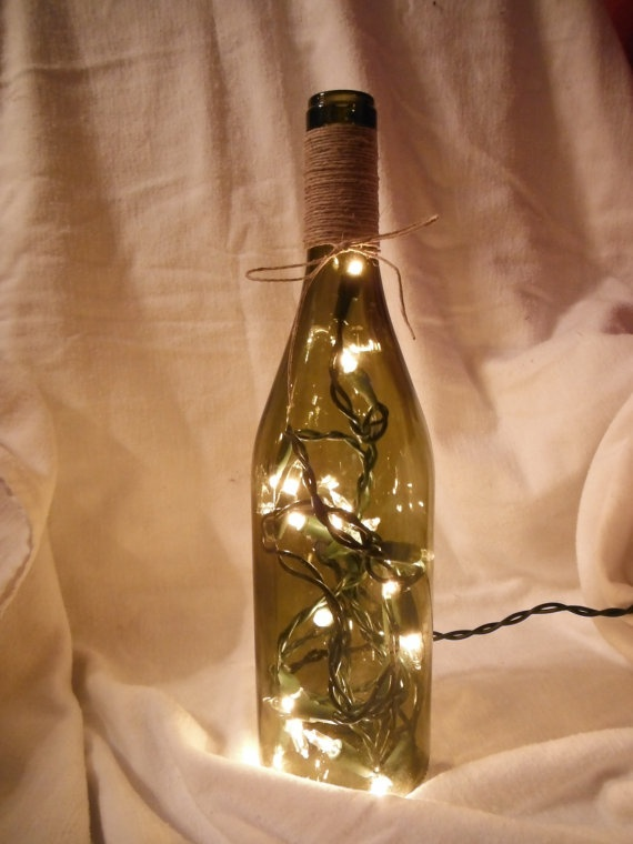I have blue Wine bottles add lights and a little decor like silver Christmas decorations and bow