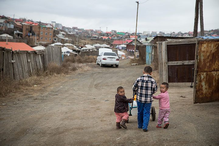 Credit: Dan Chung for the Guardian Children cart water in the Bayan Khoshuu district in the north of Ulan Bator.