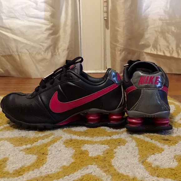 NIKE Shocks Hot Pink and Black Pink and black leather NIKE Shocks sneakers. Sliver accents have a sparkly finish to them. Have been worn a decent amount but still in good shape. Nike Shoes Sneakers