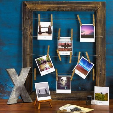 Polaroid's Rustic Clothesline frame is pretty darn cool (http://www.polaroidfotobar.com/products/Polaroid-Accessories-Gifts/Rustic-Collection/3578/37630/Rustic-Clothesline-Frame)
