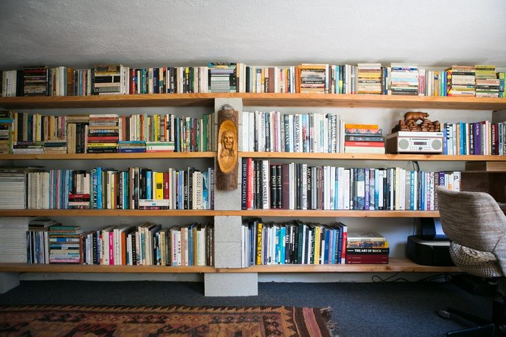 bookshelves made with wood and cinder blocks. Gregory and Jenny's Relaxed Hippie Bungalow