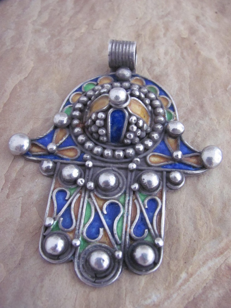 Berber Hamza Fatima Hand pendant from the Anti Atlas region in southern Morocco   Silver with enamel   The hamsa hand (Arabic) or hamesh hand (Hebrew) is an old amulet for magical protection from the envious or evil eye, used in both Jewish and Islamic populations.