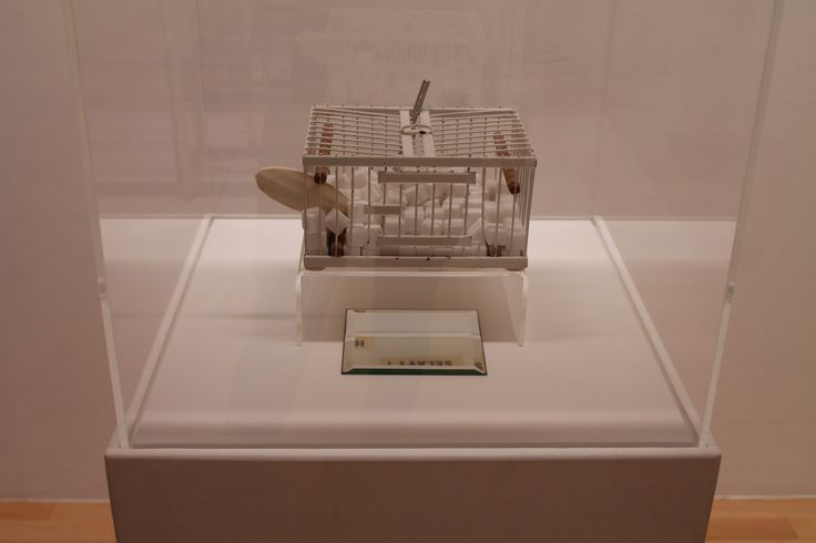 "This was my favorite piece in the tate in Liverpool - the cage and it's whiteness represent ""frigidity"" and the birdcage is a symbol on confinement, the sugar representing sex, therefore the overall model showing the suppression of  erotic climax."