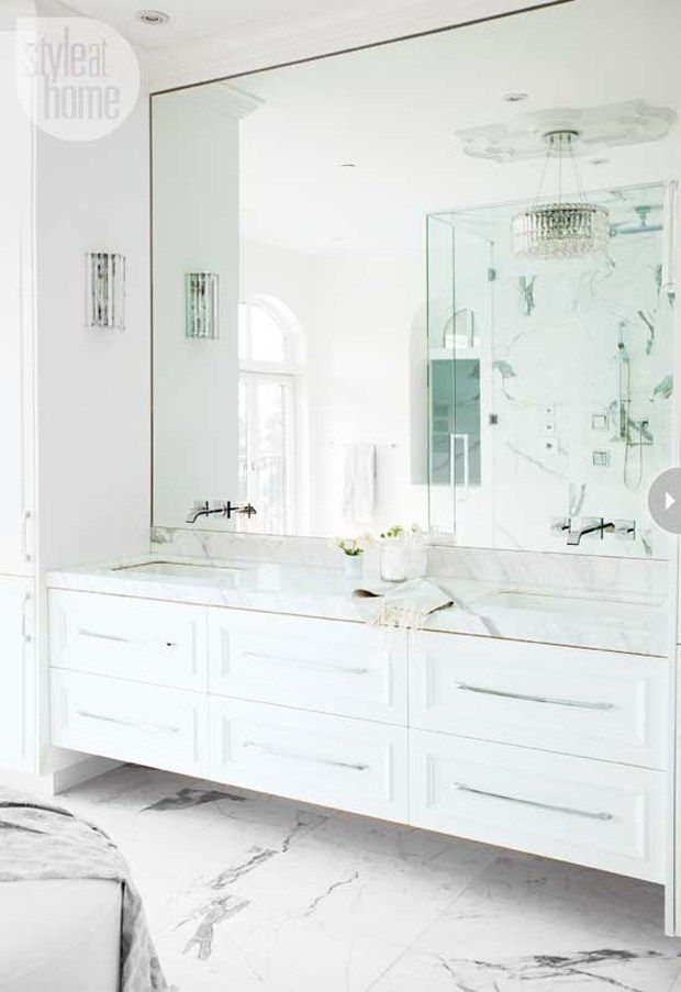 Bathroom with a marble floating vanity designed by The Cross Design, via @sarahsarna.                                                                                                                                                      More