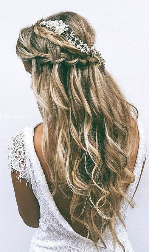 18 Elegant Hairstyles for Prom: #17. Floral, Wavy Half Updo