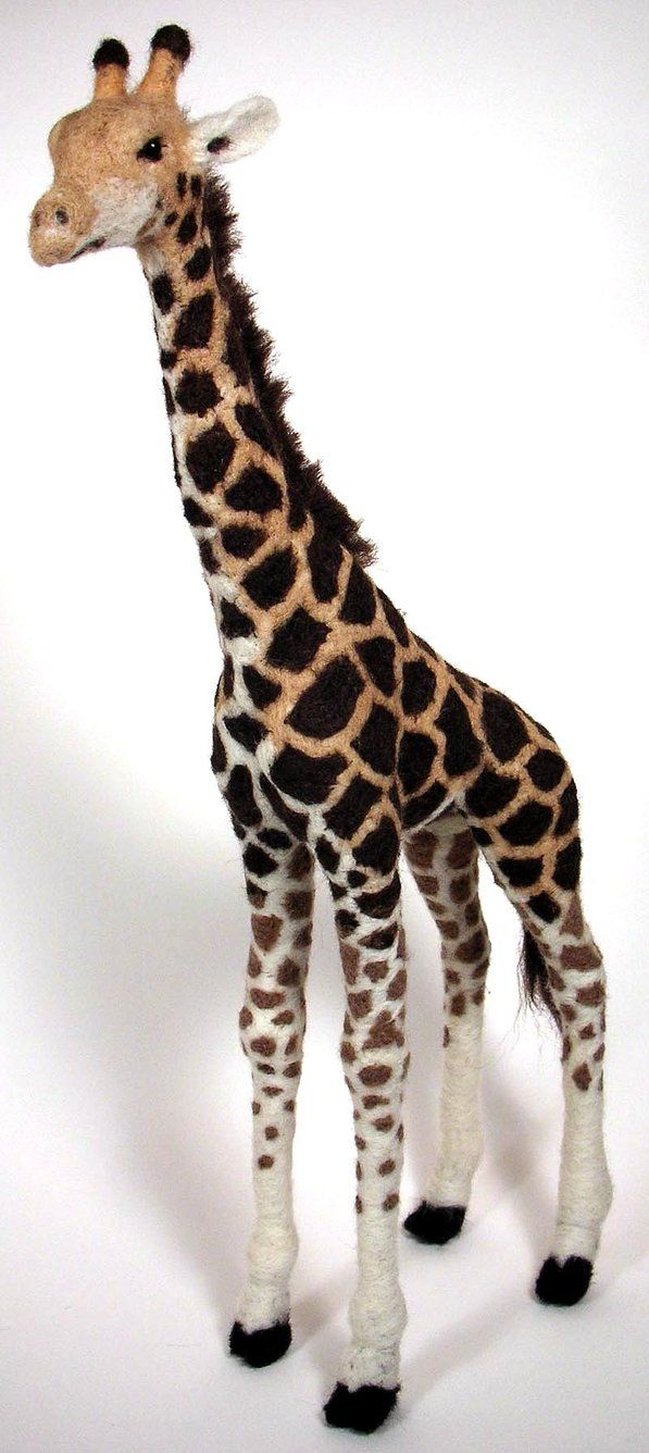 Yet another. Gawd this is addicting. Needle felted giraffe that stands 17 inches tall. Felting is just like sculpting, but with wool. The wool is poked over and over again with the felting needle w...