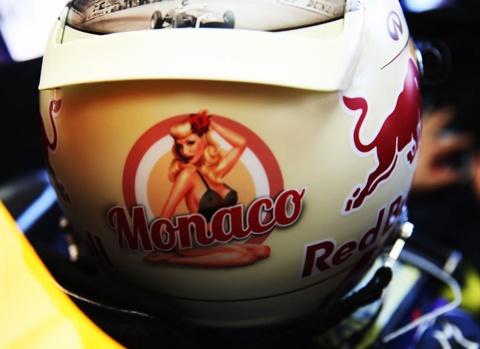 Sebastian Vettel helmet featuring glitz of Monaco on back side of it.