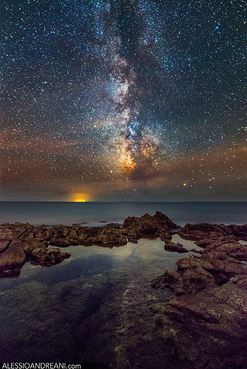 """Milky Way over Tirreno by Alessio Andreani on 500px. """"The night sky over the Mar Tirreno (italy), Tyrrhenian Sea in english, The orange light in the background come from the island of Ponza.""""Ponza, province of Latina , Lazio"""