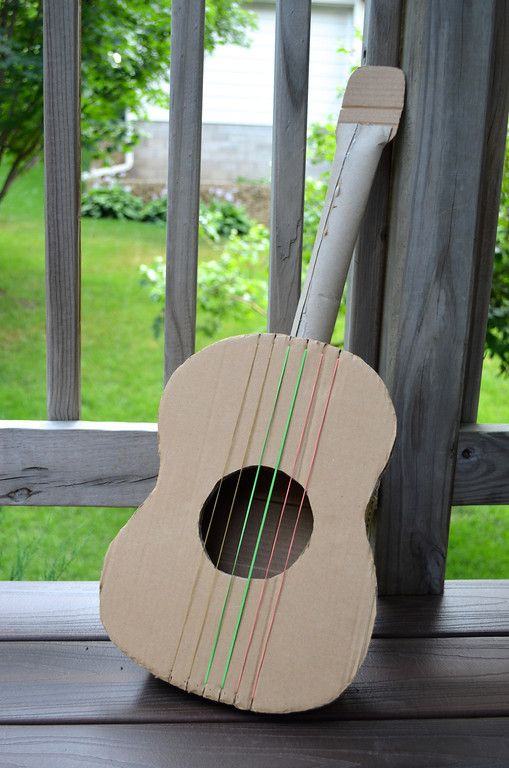 Love this DIY Cardboard Guitar tutorial from ikat bag. You can play it! (Kind of.)