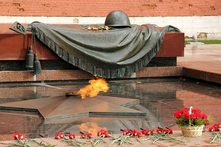 tomb-of-unknown-soldier-moscow The Russian Tomb of the Unknown Soldier is located in Moscow, at the Kremlin Wall in the Alexander Garden. The remains of the unknown soldiers killed in the Battle of Moscow in 1941 were initially buried in a mass grave at the city of Zelenograd, but was relocated to the Kremlin Wall in 1966. The dark red porphyry monument is decorated with a bronze sculpture of a laurel branch and a soldier's helmet laid upon a banner.